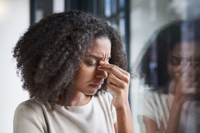 Woman in pain from migraine headache